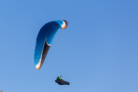 one paragliding in the sky Stock Photo