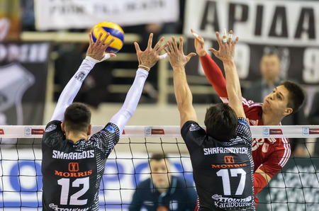 thessaloniki: Thessaloniki, Greece - February 6, 2017: The team players in action during the Hellenic Volleyball League game Paok vs Olympiacos at PAOK Sports Arena.
