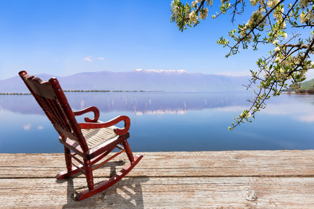 Miniature of a Rocking Chair in front of a lagoon, symbolizing relaxation at the beach