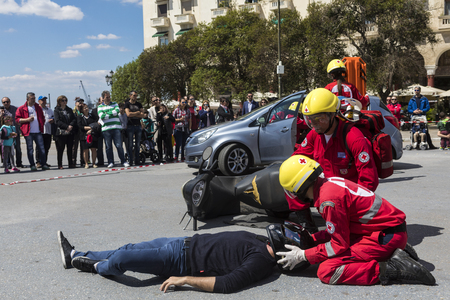 Thessaloniki , Greece - April 9, 2017: First aid, victim liberation in an car accident and helmet removal demonstration by the Hellenic Red Cross rescue team Editöryel
