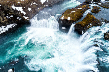 Aerial view of famous Godafoss is one of the most beautiful waterfalls on the Iceland. It is located on the north of the island. Soft focus