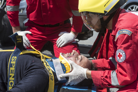 thessaloniki: Thessaloniki , Greece - April 9, 2017: First aid, victim liberation in an car accident and helmet removal demonstration by the Hellenic Red Cross rescue team Editorial