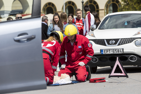 Thessaloniki , Greece - April 9, 2017: First aid, victim liberation in an car accident and helmet removal demonstration by the Hellenic Red Cross rescue team Editorial