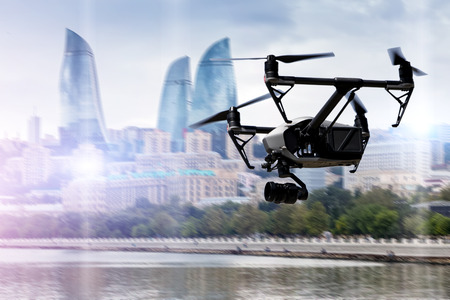 Drone flying over Baku city on blurred background. Banque d'images
