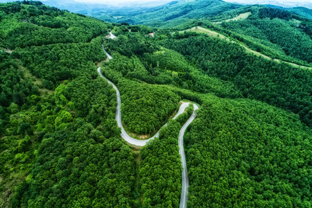 thoroughfare: Aerial view of a provincial road passing through a forest ?n Chalkidiki, northern Greece Stock Photo