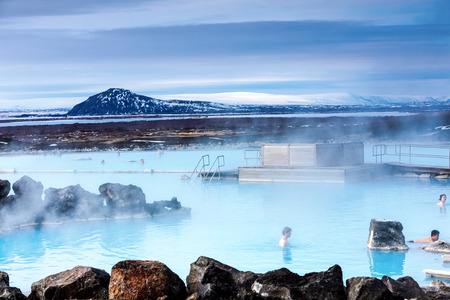 Myvatn, Iceland - March 29, 2017: View of the Myvatn Naturebaths, with bathers, a geothermal hot lagoon in Northeast Iceland Editorial