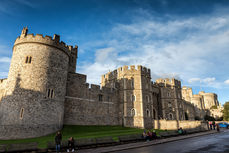 windsor: Windsor castle, England - March 22, 2017: Outside landscape of Medieval Windsor Castle. Windsor Castle is a royal residence at Windsor in the English county of Berkshire.