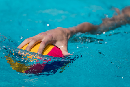 Thessaloniki, Greece May 4, 2017 : Close-up on a hand holding the water polo ball during the Greek League water polo game PAOK vs Glifada Editorial