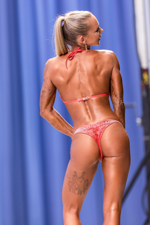 Thessaloniki, Greece - May 20, 2017: Female fitness models show their best pose at championship on stage at the 2017 WFF Mediterranean Games Bodybuilding and Fitness Editorial