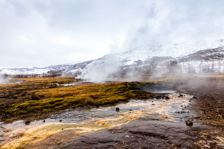 Erupting of the Great Geysir lies in Haukadalur valley on the slopes of Laugarfjall hill. Erlie morning in Southwestern Iceland