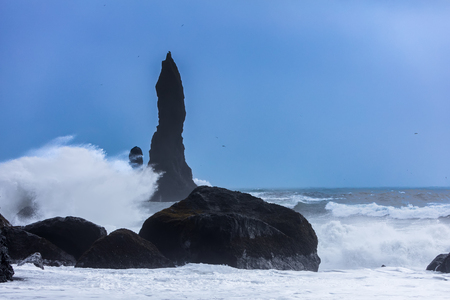 Turbulent waves that crash with great power on the black beach of Reynisfjara in the area of Vik in Iceland
