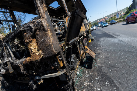 Thessaloniki, Greece - June 25, 2017: A tourist bus got fire and burned completely on the peripheral road of Thessaloniki. Passengers have been taken safely and harmless Editorial