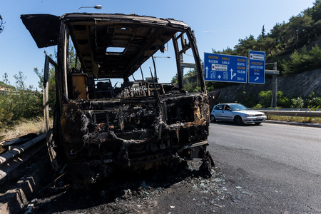 pileup: Thessaloniki, Greece - June 25, 2017: A tourist bus got fire and burned completely on the peripheral road of Thessaloniki. Passengers have been taken safely and harmless Editorial