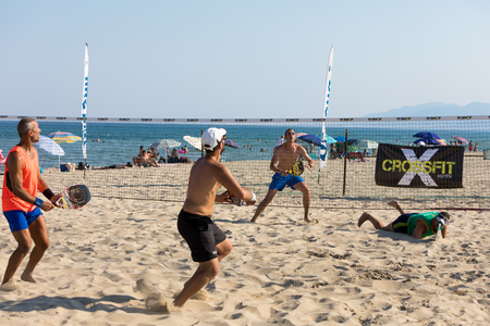 Xanthi, Greece - July 9, 2017: unidentified players during the 1st white beach tennis tournament for the local championship on the Erasmus Beach in Xanthi