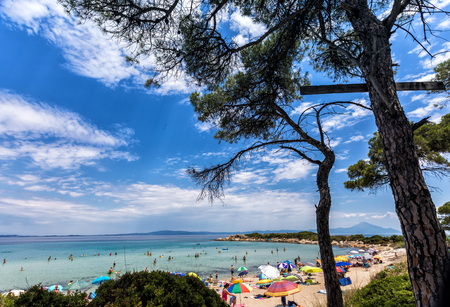 Chalkidiki, Greece - June 20, 2017: The beautiful Karidi beach in the Vourvourou of Chalkidiki, which is visited by hundreds of tourists daily from the Balkans and from Europe Editorial