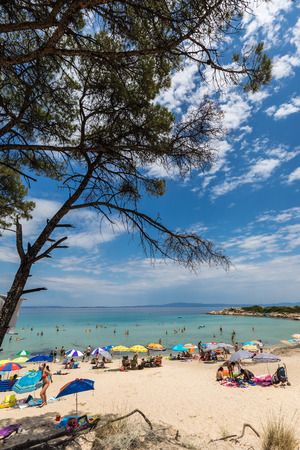 hundreds: Chalkidiki, Greece - June 20, 2017: The beautiful Karidi beach in the Vourvourou of Chalkidiki, which is visited by hundreds of tourists daily from the Balkans and from Europe Editorial