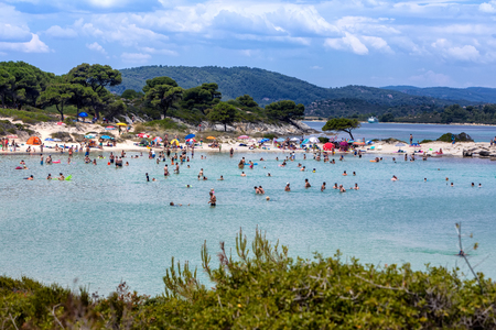 balkans: Chalkidiki, Greece - June 20, 2017: The beautiful Karidi beach in the Vourvourou of Chalkidiki, which is visited by hundreds of tourists daily from the Balkans and from Europe Editorial