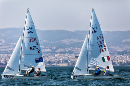 Thessaloniki, Greece - July 12, 2017: Athletes yachts in action during 2017 Mens 470 World Championship class sailing
