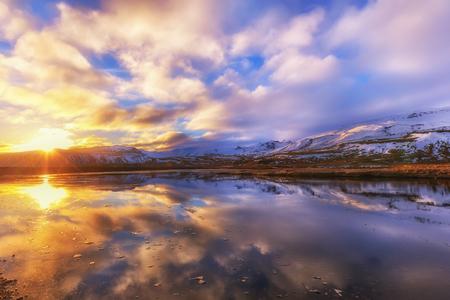 Colorful sunrise near Grundarfjordur town. Morning scene on the Snaefellsnes peninsula, Iceland, Europe. Artistic style post processed photo. Stock Photo