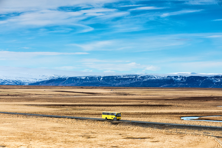 Typical Iceland landscape with road and mountains.