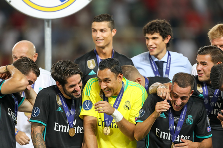 Skopje, FYROM - August 8,2017: Real Madrid celebrate with the trophy after defeating Manchester United 2-1 during the Super Cup final soccer match at Philip II Arena in Skopje Editorial