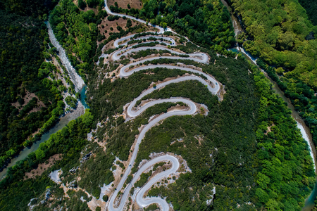 thoroughfare: Aerial view of the provincial with many zigzag road in the Epirus Zagorohoria, Greece Stock Photo