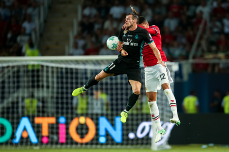 Skopje, FYROM - August 8,2017:Real Madrid G. Bale (L) and Manchester United Ch.Smalling (R) during the UEFA Super Cup Final match between Real Madrid and Manchester United at Philip II Arena in Skopje