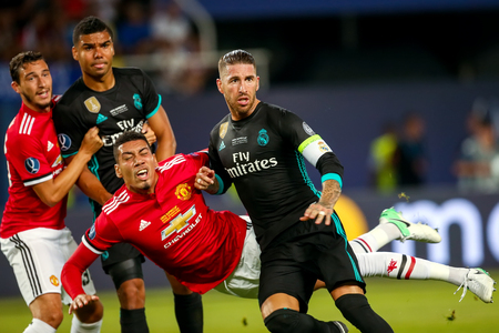 Skopje,FYROM-August 8,2017:Real Madrid S. Ramos (R) and Manchester United J. Lingard (2R) during the UEFA Super Cup Final match between Real Madrid and Manchester United at Philip II Arena in Skopje Stok Fotoğraf - 84383552