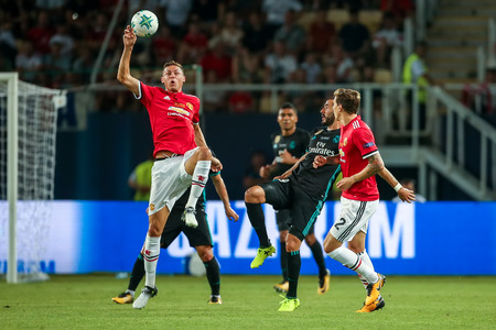 Skopje, FYROM-August 8,2017: Real Madrid D. Carvajal (R) and Manchester United N. Matic (L) during the UEFA Super Cup Final match between Real Madrid and Manchester United at Philip II Arena in Skopje Stok Fotoğraf - 84383556