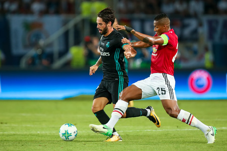Skopje, FYROM-August 8,2017:Real Madrid Isco (L) and Manchester United Antonio Valencia (R) during the UEFA Super Cup Final match between Real Madrid vs Manchester United at Philip II Arena in Skopje Editöryel