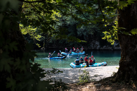 Zagori, Epirus, Greece - August 29, 2017: Adventure team doing rafting on the cold waters of the Voidomatis River in Zagori. Voidomatis river is one of the most popular among rafters in Greece