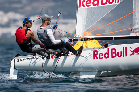 world championships: Thessaloniki, Greece - August 30, 2017: Athletes yachts in action during 2017 Tornado Open World, Global Mixed and Youth championships