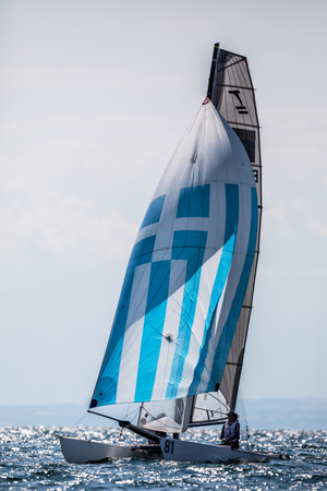 bateau de course: Thessaloniki, Greece - August 30, 2017: Athletes yachts in action during 2017 Tornado Open World, Global Mixed and Youth championships