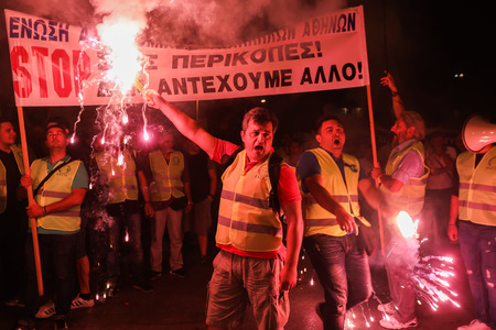 public welfare: Thessaloniki, Greece - September 8, 2017: Policemen with torches, firefighters and port policeman protest in Thessaloniki against further cuts on their payroll
