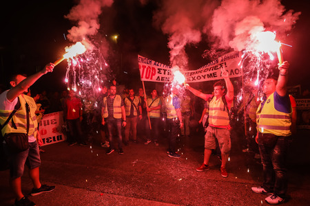 Thessaloniki, Greece - September 8, 2017: Policemen with torches, firefighters and port policeman protest in Thessaloniki against further cuts on their payroll