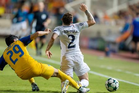 Nicosia, Cyprus - Semptember 26, 2017: Player of Tottenham Kieran Trippier (R) and of APOEL Praxitelis Vouros (L) in action during the UEFA Champions League game between APOEL VS Tottenham Hotspur