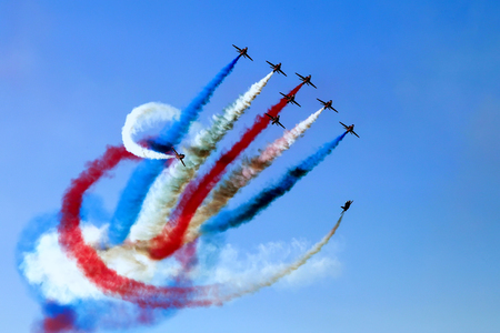 Experts pilots showing aerobatics up in the sky at the Athens air week flying show Zdjęcie Seryjne - 87846743