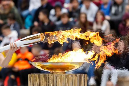 Athene, Griekenland - 31 oktober, 1717: De Olympische vlam werd overhandigd aan de organisatoren van de Olympische Winterspelen Pyeongchang (Zuid-Korea) 9-25 februari 2018. de ceremonie werd gehouden in het Panathenaic Kallimarmaro Stadium Redactioneel