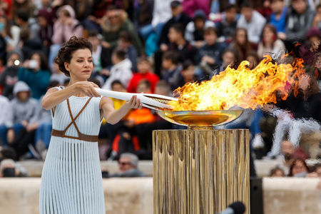 Athens, Greece - Oct 31,2017: The Olympic flame was handed to organizers of the Pyeongchang (South Korean) Winter Olympics Feb. 9-25, 2018. the ceremony was held in Panathenaic Kallimarmaro Stadium Imagens - 89159798
