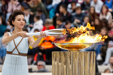 Athens, Greece - Oct 31,2017: The Olympic flame was handed to organizers of the Pyeongchang (South Korean) Winter Olympics Feb. 9-25, 2018. the ceremony was held in Panathenaic Kallimarmaro Stadium 版權商用圖片 - 89159804