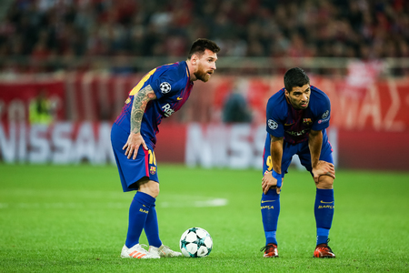Piraeus, Greece - October 31, 2017: Player of Barcelona Luis Suarez (R) and  Lionel Messi (L) during the UEFA Champions League game between Olympiacos vs FC Barcelona at Georgios Karaiskakis stadium Editorial