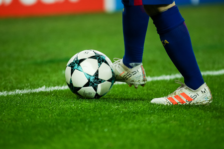 Piraeus, Greece - October 31, 2017: The feet of Lionel Messi with ball during the UEFA Champions League game between Olympiacos vs FC Barcelona at Georgios Karaiskakis stadium