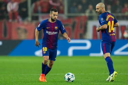 Piraeus, Greece - Oct 31, 2017: Player of Barcelona Jordi Alba (L) and Javier Mascherano (R) during the UEFA Champions League game between Olympiacos vs FC Barcelona at G. Karaiskakis stadium
