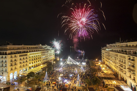 Thessaloniki, Greece -January 1, 2017:  General view in Aristotles square in Thessaloniki  during New Year celebrations with fantastic multi-colored fireworks, on the night sky