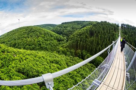 aerial view Germanys longest rope suspension bridge 300 feet above a canyon floor Geierley. It is between the towns of Morsdorf and Sosberg Stok Fotoğraf