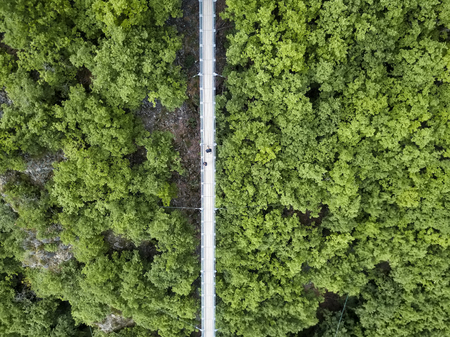 aerial view Germanys longest rope suspension bridge 300 feet above a canyon floor Geierley. It is between the towns of Morsdorf and Sosberg Standard-Bild
