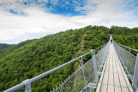aerial view Germanys longest rope suspension bridge 300 feet above a canyon floor Geierley. It is between the towns of Morsdorf and Sosberg Standard-Bild