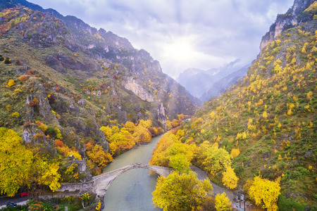 Aerial view of Konitsa stone bridge and Aoos River an autumn day, Greece. National park