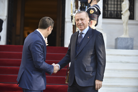 Athens, Greece - December 7, 2017: Greeces Prime Minister Alexis Tsipras (L) welcomes the President of Turkey, Recep Tayyip Erdogan (R) at the Maximos Mansion in Athens, Greece