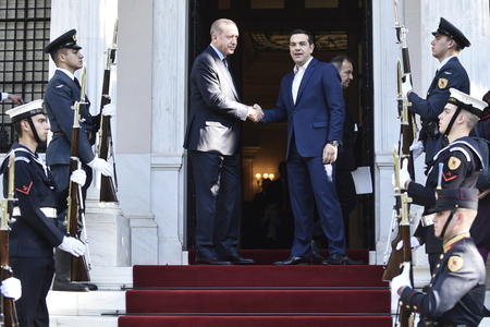 Athens, Greece - December 7, 2017: Greeces Prime Minister Alexis Tsipras (R) welcomes the President of Turkey, Recep Tayyip Erdogan (L) at the Maximos Mansion in Athens, Greece Editorial